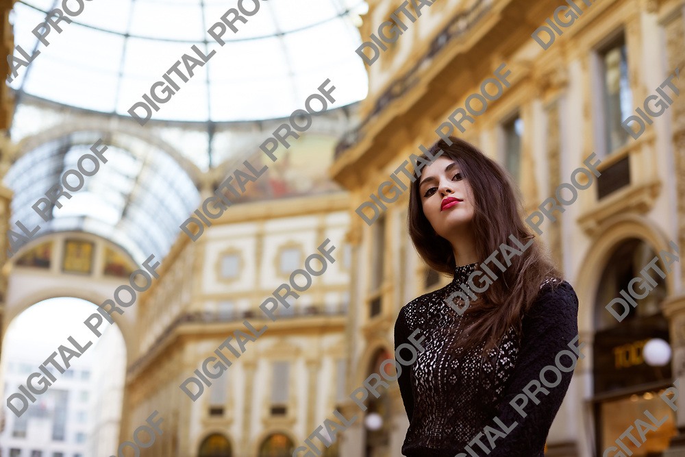 Milan, Italy - January 30, 2020 Portrait of a Female Model with the interior of Galleria Vittorio Emanuele II in the background during the day