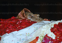Indian Prime Miniter Indira Gandi's body lies in State at her residence in New Delhi,India in November 1984 after her assassination by her bodyguards. Photograph by Jayne Fincher