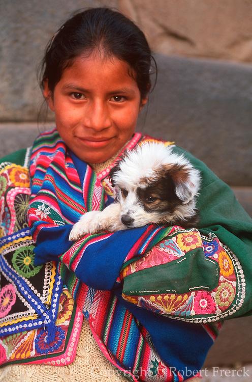 PERU, HIGHLANDS, CUZCO young Quechua Indian girl with puppy