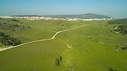 """Aerial drone photography of the Peace Valley with Yokneam (Yokneam Illit) in the background Yokneam Illit  is a city in northern Israel. It is located in a hilly region of the lower Galilee at the base of the Carmel Mountains, and overlooks the Jezreel Valley. It is 21 kilometres (13 miles) from Haifa and 80 kilometres (50 mi) from Tel Aviv. Yokneam is known as Israel's """"Startup Village,"""" because its high-tech hub is surrounded by forest and small communities."""