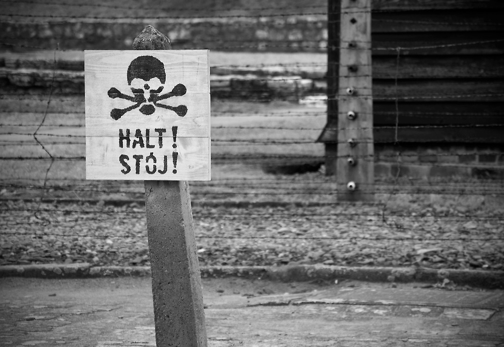 One of the many signs haunting the Auschwitz site.