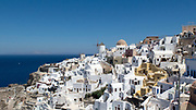 Beautiful Morning view of Oia, Santorini, Greece. White village with windmill in distance