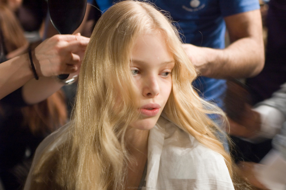 model having her hair done backstage before Ungaro fashion show