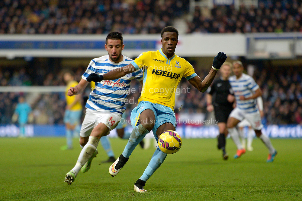 Wilfried Zaha of Crystal Palace in action. Barclays Premier league match, Queens Park Rangers v Crystal Palace at Loftus Road in London on Sunday 28th December 2014.<br /> pic by John Patrick Fletcher, Andrew Orchard sports photography.