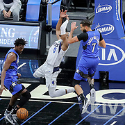 ORLANDO, FL - MARCH 01: Michael Carter-Williams #7 of the Orlando Magic fouls Josh Richardson #0 of the Dallas Mavericks during the first half at Amway Center on March 1, 2021 in Orlando, Florida. NOTE TO USER: User expressly acknowledges and agrees that, by downloading and or using this photograph, User is consenting to the terms and conditions of the Getty Images License Agreement. (Photo by Alex Menendez/Getty Images)*** Local Caption *** Michael Carter-Williams; Josh Richardson