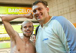 Bostjan Buc of Slovenia and Miro Vodovnik joking after thew competed during day four of the 20th European Athletics Championships at the Olympic Stadium on July 30, 2010 in Barcelona, Spain.  (Photo by Vid Ponikvar / Sportida)