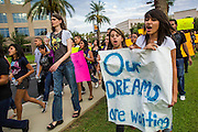 15 AUGUST 2012 - PHOENIX, AZ: People march on the Arizona State Capitol Wednesday. About 200 people, mostly DREAM Act  (an acronym for Development, Relief, and Education for Alien Minors) students and their family members, marched on the Arizona State Capitol in Phoenix Wednesday after Arizona Governor Jan Brewer said the state of Arizona will not give DREAM Act students any state services, including driver's licenses or tuition breaks on state universities and schools. Brewer has been a critic of President Obama's plan to defer deportations of certain undocumented young people.   PHOTO BY JACK KURTZ