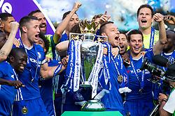 Retiring captain John Terry lifts the trophy (with Gary Cahill) as Chelsea celebrate winning the 2016/17 Premier League - Rogan Thomson/JMP - 21/05/2017 - FOOTBALL - Stamford Bridge - London, England - Chelsea v Sunderland - Premier League..
