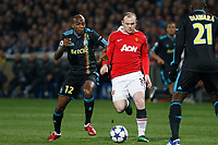 FOOTBALL - CHAMPIONS LEAGUE 2010/2011 - 1/8 FINAL - 1ST LEG - OLYMPIQUE MARSEILLE v MANCHESTER UNITED - 23/02/2011 - PHOTO PHILIPPE LAURENSON / DPPI - WAYNE ROONEY / CHARLES KABORE (OM)