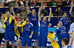 Team of Serbia celebrates during the EuroBasket 2009 Quaterfinals match between Russia and Serbia, on September 17, 2009 in Arena Spodek, Katowice, Poland.  (Photo by Vid Ponikvar / Sportida)