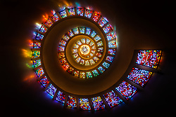 """Stained glass spiral (""""The Glory Window"""") in Thanks-Giving Square , which is dedicated to promoting the concept of giving thanks as a universal, human value. Chapel designed by Philip Johnson, stained glass by  Gabriel Loire.  Dallas, Texas, USA."""
