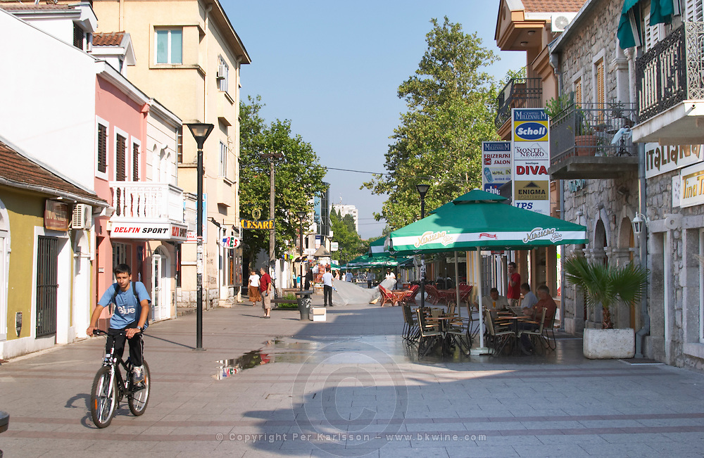A pedestrian street in the centre of the city. Cafe with outside seating terrace. Hercegovacka Street. Podgorica capital. Montenegro, Balkan, Europe.