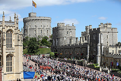 Guards of the Blues and Royals regiment and the military band march around the crowds waiting for Royal family and The Knights of the Garter to arrive during the annual Order of the Garter Service at St George's Chapel, Windsor Castle.