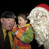 Little Erica Webb from Killarney prefers to tell Jackie Healy-Rae what she wants for christmnas aa santa can only look on at the switchin on of 3,000 light at Tim Clifford's home in Beaufort on Saturday.<br />
