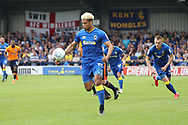 AFC Wimbledon striker Lyle Taylor (33) dribbling and starting an attack during the EFL Sky Bet League 1 match between AFC Wimbledon and Oldham Athletic at the Cherry Red Records Stadium, Kingston, England on 21 April 2018. Picture by Matthew Redman.