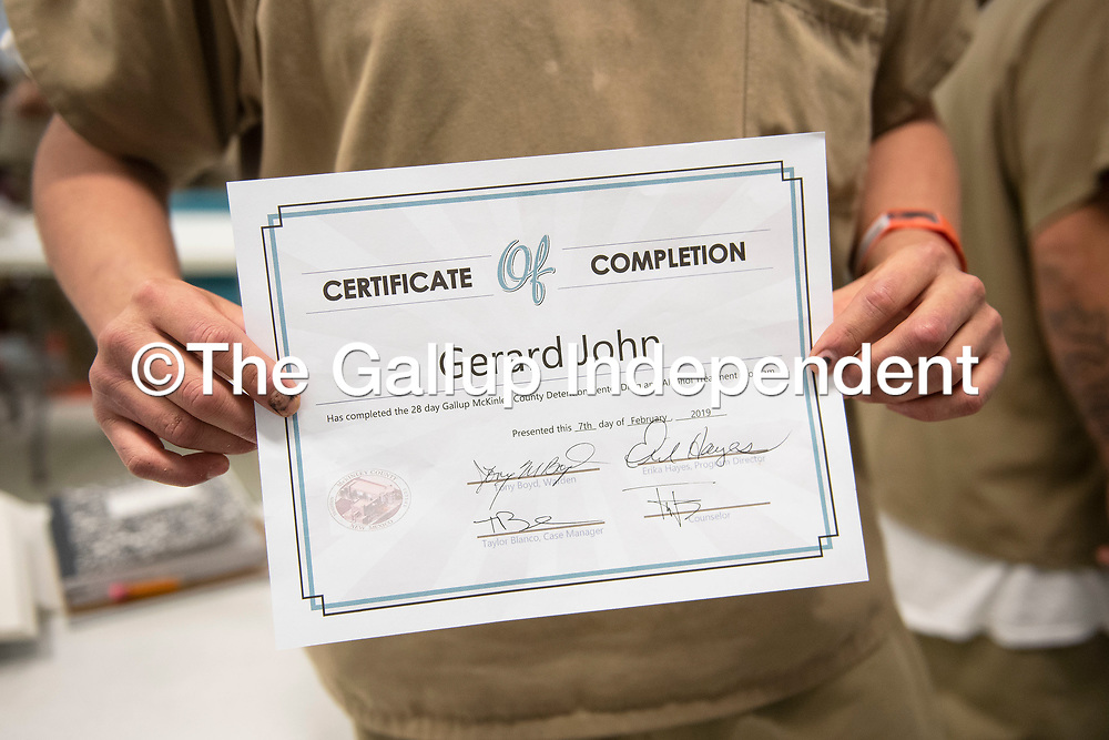 Gerard John holds his certificate for completing the substance abuse treatment program at the McKinley County Adult Detention Center, Thursday, Feb. 7.