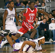 2/11/06 -- Omaha, Ne.Reserve Christian's Daniel Johnson races past Omaha Central's Lorenzo Wilson and a fallen Rodney Grace. at The Omaha Shootout, a High School Basketball tournament featuring some of the best prospects at the Qwest Center Omaha...(Photo by Chris Machian/Prarie Pixel Group).