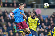 Scunthorpe United Defender, Murray Wallace (5) beats Oxford United Defender, Cheyenne Dunkley (33) to the ball during the EFL Sky Bet League 1 match between Oxford United and Scunthorpe United at the Kassam Stadium, Oxford, England on 18 March 2017. Photo by Adam Rivers.