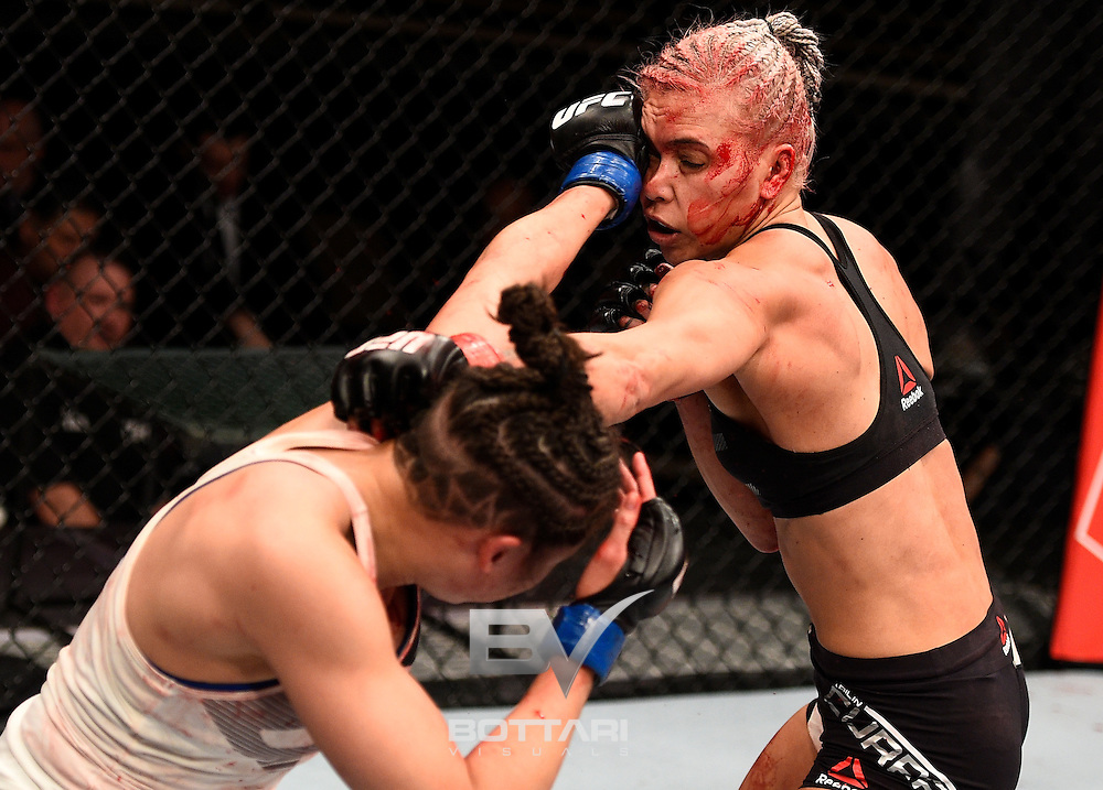 LAS VEGAS, NV - DECEMBER 03:  (L-R) Jamie Moyle punches Kailin Curran in their women's strawweight bout during The Ultimate Fighter Finale event inside the Pearl concert theater at the Palms Resort & Casino on December 3, 2016 in Las Vegas, Nevada. (Photo by Jeff Bottari/Zuffa LLC/Zuffa LLC via Getty Images)
