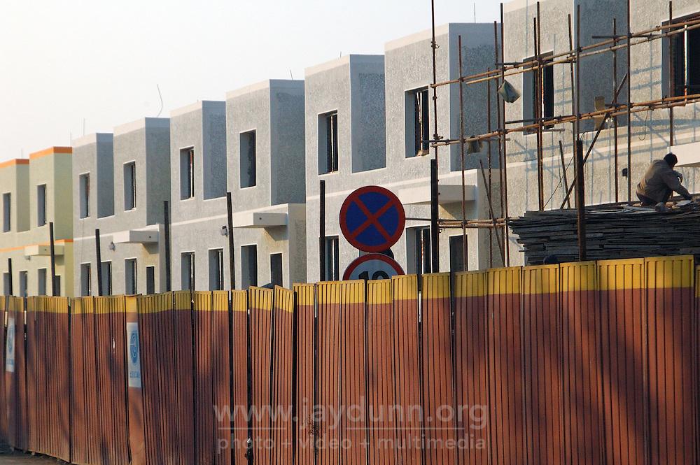 China, Beijing, Ping Fang Xiang, 2008. North of Chao Yang Bei Lu outside the 5th Ring Road, a new housing community takes shape on former Ping Fang Xiang fields..