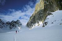 Two skiers ski Ruth Glacier below Mt. Dickey in Denali National Park.