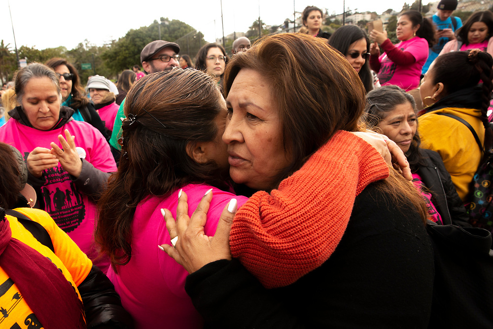 """Guillermina Castellanos (front) embraces Marcela Escamilla at a rally against the housing proposal often referred by critics as the """"Monster in the Mission,"""" on Thursday, Feb. 7, 2019, in San Francisco, Calif. A community meeting was held at Mission High School to hear public reaction on the housing project for 1979 Mission Street."""