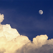 Cumulus thunderclouds billow around moonrise over the Bridger Mountains in southwest Montana.