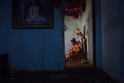 Six-year-old Unika Vajracharya days after her selection as Patan's living goddess. A room in the house—a precious commodity in the overcrowded city of Kathmandu—must be set aside as a puja, or worship room, with a throne where the goddess can receive devotees.