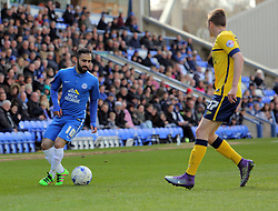 Erhun Oztumer of Peterborough United takes on Conor Townsend of Scunthorpe United.- Mandatory by-line: Joe Dent/JMP - 23/04/2016 - FOOTBALL - ABAX Stadium - Peterborough, England - Peterborough United v Scunthorpe United - Sky Bet League One