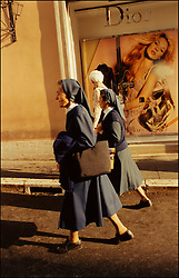 © 2005 Jackie Neale Chadwick, Nuns walked unaffectedly by a seductive ad in Rome, Italy.