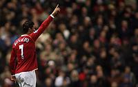 Photo: Paul Thomas.<br /> Manchester United v Wigan Athletic. The Barclays Premiership. 26/12/2006.<br /> <br /> Cristiano Ronaldo celebrates (L) his 1st goal for Man Utd.