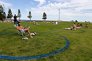 Circles are seen painted on the grass at St Kilda Beach to help locals socially distance from each other as the weather warms up during COVID-19 in Melbourne, Australia. Premier Daniel Andrews comes down hard on Victorians breaching COVID 19 restrictions, threatening to close beaches if locals continue to flout the rules. This comes as Victoria sees single digit new cases. (Photo by Dave Hewison/Speed Media)