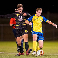 BRISBANE, AUSTRALIA - AUGUST 26: Fraser Eller of the Strikers is fouled by Rhys Gwynn-Jones of Moreton Bay during the NPL Queensland Senior Men's Semi Final match between Brisbane Strikers and Moreton Bay Jets at Perry Park on August 26, 2017 in Brisbane, Australia. (Photo by Patrick Kearney)