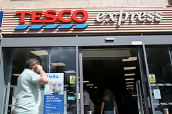 © Licensed to London News Pictures. 05/08/2019. London, UK. A man walks past Tesco Express on Green Lanes, Haringey, north London. <br /> According to Tesco, it is to cut 4,500 jobs from its 153 Metro stores and 134 Express stores in latest round of redundancies. Photo credit: Dinendra Haria/LNP
