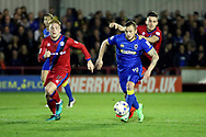 AFC Wimbledon midfielder Dean Parrett (18) dribbling and battles for possession during the EFL Sky Bet League 1 match between AFC Wimbledon and Rochdale at the Cherry Red Records Stadium, Kingston, England on 28 March 2017. Photo by Matthew Redman.