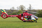 The Thames Valley Air Ambulance helicopter is pictured on 7th May 2021 in Windsor, United Kingdom. Thames Valley Air Ambulances Airbus H135, with a maximum speed of 160mph, is able to reach any destination in Berkshire, Buckinghamshire or Oxfordshire within fifteen minutes.
