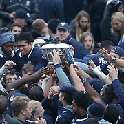 NEW HAVEN, CONNECTICUT - NOVEMBER 18: The Yale team with the trophy after the Yale V Harvard, Ivy League Football match at the Yale Bowl. Yale won the game 24-3 to win their first outright league title since 1980. The game was the 134th meeting between Harvard and Yale, a historic rivalry that dates back to 1875. New Haven, Connecticut. 18th November 2017. (Photo by Tim Clayton/Corbis via Getty Images)