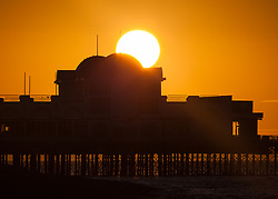 © Licensed to London News Pictures. 12/09/2017. Southsea, UK.  Clear, orange skies during sunrise over Southsea Pier this morning, 12th September 2017. Photo credit: Rob Arnold/LNP