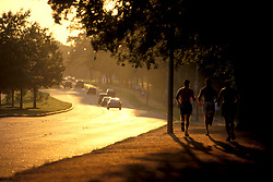 Stock photo of men jogging along the trail at Memorial Park.