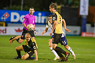 Marine defender Anthony Miley (5) tussles for the ball ahead of Tottenham Hotspur forward Carlos Vincius (45) during the The FA Cup match between Marine and Tottenham Hotspur at Marine Travel Arena, Great Crosby, United Kingdom on 10 January 2021.