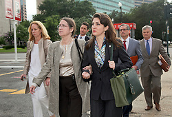 01 June  2015. New Orleans, Louisiana. <br /> Rita Benson LeBlanc (rt)) and her mother Renee (center) leave New Orleans Civil District Court surrounded by lawyers following a hearing to determine the competency of grandfather/father Tom Benson. Benson is the billionaire owner of the NFL New Orleans Saints, the NBA New Orleans Pelicans, various Mercedes dealerships, banks, property assets and a slew of business interests. Rita, her brother and mother demanded a competency hearing after Benson changed his succession plans and decided to leave the bulk of his estate to third wife Gayle, sparking a controversial fight over control of the Benson business empire.<br /> Photo©; Charlie Varley/varleypix.com