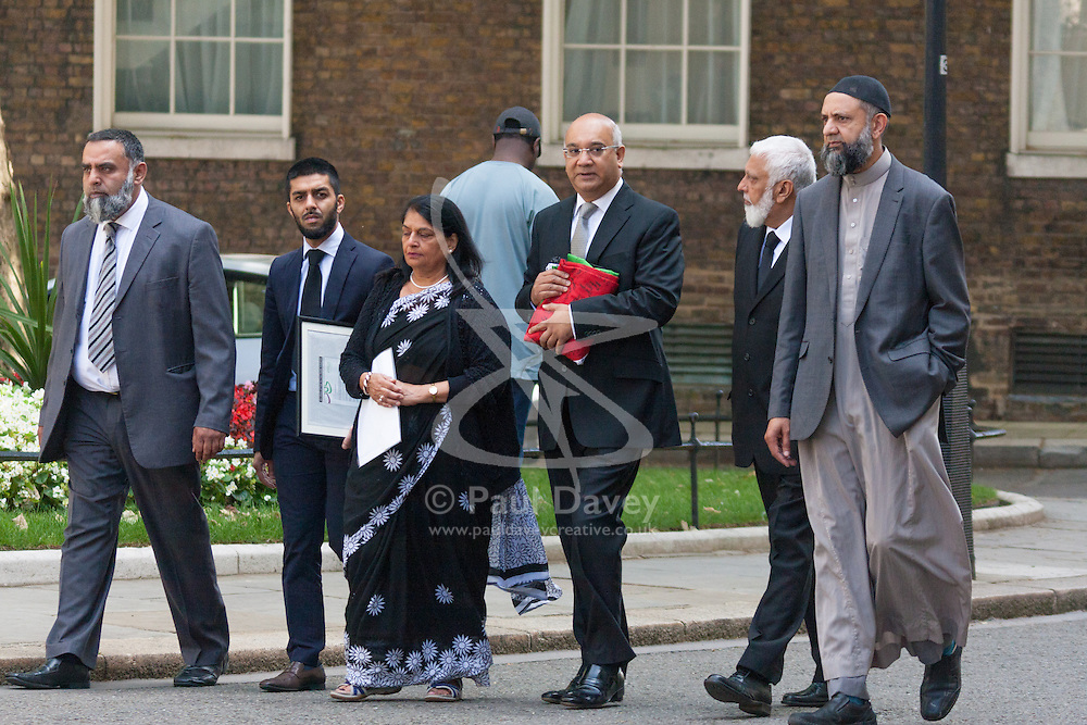 """London, July 30th 2014. Representatives from the Federation of Muslim Organisations from Leicestershire accompanied by Keith Vaz MP, Leicester East, deliver a """"Palestinian Peace Flag"""" signed by hundreds, calling on the Prime Minister to help encourage an immediate ceasefire in the Israeli-Palestinian conflict."""