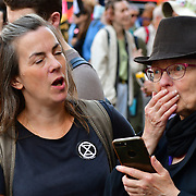 Piccadilly Circus, London, UK. 2021-08-25. Extinction Rebellion activists Courage Calls To Courage Day 3 for the climate crisis is unfolding alongside the crises of poverty, covid and inequality.