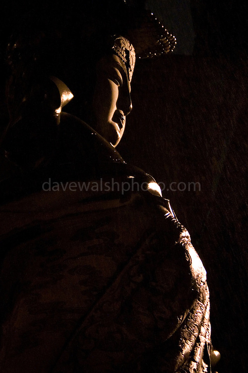 Guan Yin is the bodhisattva of compassion as venerated by East Asian Buddhists, usually as a female. She is also known as the Chinese Bodhisattva of Compassion. Photographed on a raining night in Keelung