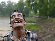 Local man enjoys the onset of monsoon rains, Goa, India