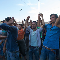 Illegal migrants hold each other's hands as they protest against circumstances in the transit zones they are kept in at the main railway station Keleti in Budapest, Hungary on September 02, 2015. ATTILA VOLGYI