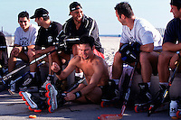22 May 1997: Twin brothers Matthew and Martin Mullen, actor Chris Nelson, hockey rep Brian Joy and other  In-line roller hockey players at the beach lacing up for an afternoon skate game.  For many years players have been skating year around in the parking lot south of the famous Santa Monica Pier in California.  Some players wear shirts others go shirtless. .