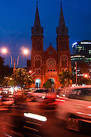 Traffic blur near Saigon Notre Dame Basilica.
