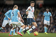 Dele Alli (Tottenham Hotspur) runs across the City defence during the Barclays Premier League match between Manchester City and Tottenham Hotspur at the Etihad Stadium, Manchester, England on 14 February 2016. Photo by Mark P Doherty.