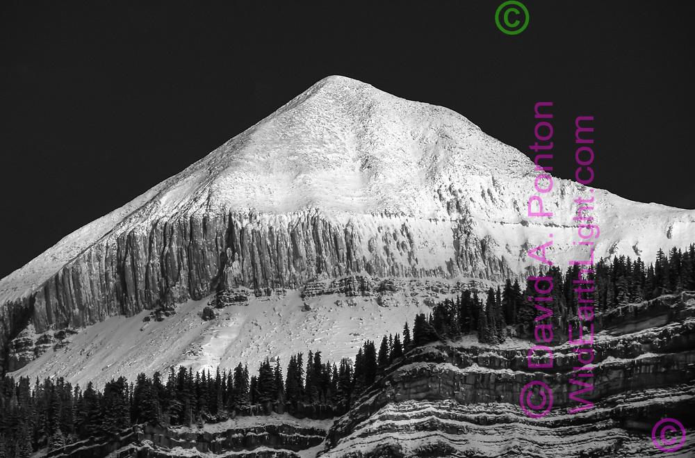 Fresh snow on Engineer Mountain makes it stand out from dark sky, San Juan Mountains, Colorado, © David A. Ponton